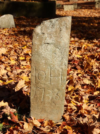 Simple marker made out of local stone at the Rhinebeck churchyard