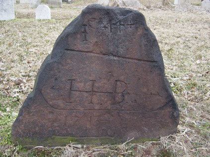 "Fig. 18 A trapezoidal marker featuring an arrow through the initials ""IIB"", 1773, Hackensack, New Jersey. Carved symbols were a rarity on non-artisanal stones in colonial Dutch settlements."